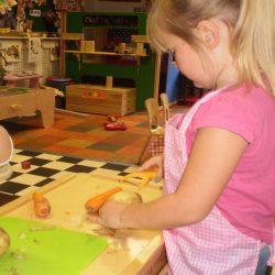 Children preparing vegetables
